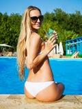 Pretty blond woman enjoying cocktail Stock Image