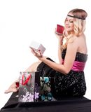 Pretty blond woman with gift bag Stock Photo