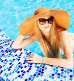 Pretty blond woman in a swimming pool Royalty Free Stock Image