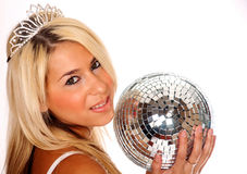 Pretty blond woman holding disco ball Stock Photo