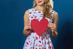 Pretty blond woman holding red paper heart Royalty Free Stock Photo