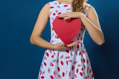 Pretty blond woman holding red paper heart Stock Photos