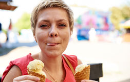 Pretty blond woman with ice cream Stock Photo