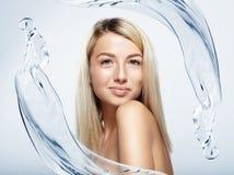 Pretty blond woman intro water splash Stock Photography