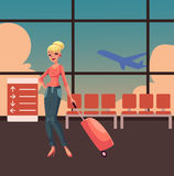Pretty blond woman in jeans and heels travelling with suitcase Stock Photos