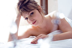 Pretty blond woman laying in bed. Close up Royalty Free Stock Photo