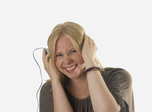 Pretty blond woman listening to music Royalty Free Stock Photography