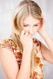Pretty blond woman looking down Royalty Free Stock Photo