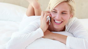 Pretty blond woman phoning stock video footage