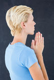 Pretty blond woman praying Royalty Free Stock Photos