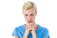 Pretty blond woman praying Stock Photo