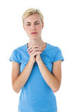 Pretty blond woman praying Stock Images