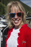 Pretty blond woman in red white and blue colors smiles, July 4, Independence Day Parade, Telluride, Colorado, USA Stock Images