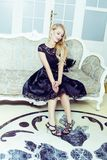 Pretty blond woman in rich luxury house interior, fashion people Stock Photo