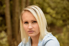 Pretty blond woman with a serious expression royalty free stock photo