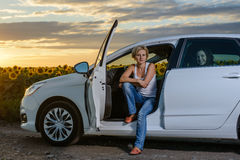 Pretty blond woman sitting waiting in her car Stock Photography
