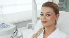 Woman smiles at the beauty salon stock video footage