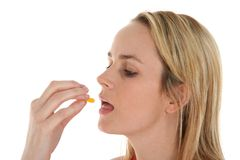 Pretty Blond Woman Taking Medicine Stock Images