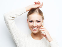 Pretty blond woman  talking on the mobile phone Royalty Free Stock Image