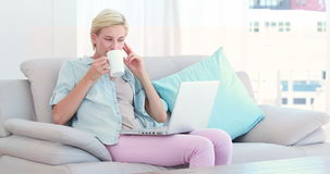 Pretty blond woman using computer stock video footage