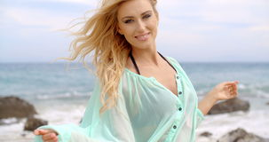 Pretty Blond Woman Wearing Light Mint Beachwear. Close up Pretty Young Blond Woman in Light Mint Beachwear Smiling at the Camera with Ocean Background stock video