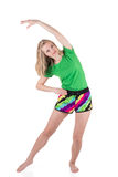 Pretty blond woman wearing in sportswear lunging and tilting to the side with hand above a head. On white background Stock Images