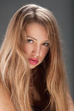 Pretty blond  young woman Stock Images