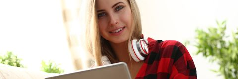 Young woman surfing the internet hold laptop in arms search information. Pretty blond young woman surfing the internet hold laptop in arms search information sit Stock Image