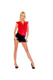 Pretty Blonde. Pretty blond woman in a red blouse and a black mini skirt Royalty Free Stock Photos