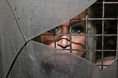 Pretty Blonde. Beautiful woman looking through cracked glass Stock Photos