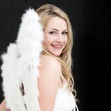 Pretty blonde angel with a bright smile Stock Photography