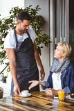 Pretty blonde arguing with the waiter Royalty Free Stock Photography