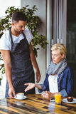 Pretty blonde arguing with the waiter Stock Image