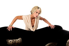 Pretty Blonde Behind Couch Royalty Free Stock Photography