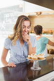 Pretty blonde being tempted by cupcakes Stock Photos