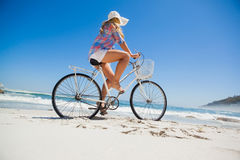 Pretty blonde on a bike ride at the beach Stock Photos