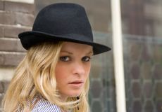 Pretty blonde in a black hat. Head portrait of a pretty blonde in a black hat Stock Photo