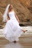 Pretty Blonde Bride Along the Ocean Royalty Free Stock Image