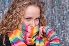 Pretty blonde in bright rainbow scarf. Looking at camera royalty free stock photo