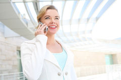 Pretty Blonde Business Woman on Cell Phone Royalty Free Stock Photo