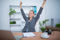 Pretty blonde businesswoman gesturing victory Stock Photography