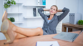Pretty blonde businesswoman relaxing herself Royalty Free Stock Photo