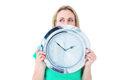 Pretty blonde in casual clothes showing clock Royalty Free Stock Image