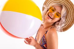 Free Pretty Blonde Caucasian Female Stands In Swimsuit With Big Rubber Beach Colourful Ball And Smiles Isolated On White Royalty Free Stock Image - 163849386