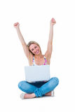 Pretty blonde cheering and having laptop Royalty Free Stock Photography