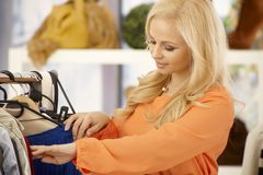 Pretty blonde at clothes store Stock Photography