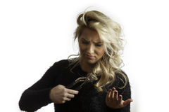 Pretty Blonde Confused Trying To Cut Hair with Pliers Royalty Free Stock Images