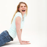 Pretty blonde doing mock push ups with a smile Stock Photography