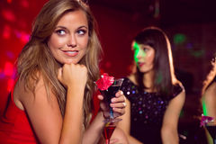 Pretty blonde drinking a cocktail Royalty Free Stock Images