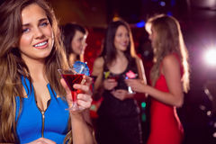 Pretty blonde drinking a cocktail Royalty Free Stock Photos